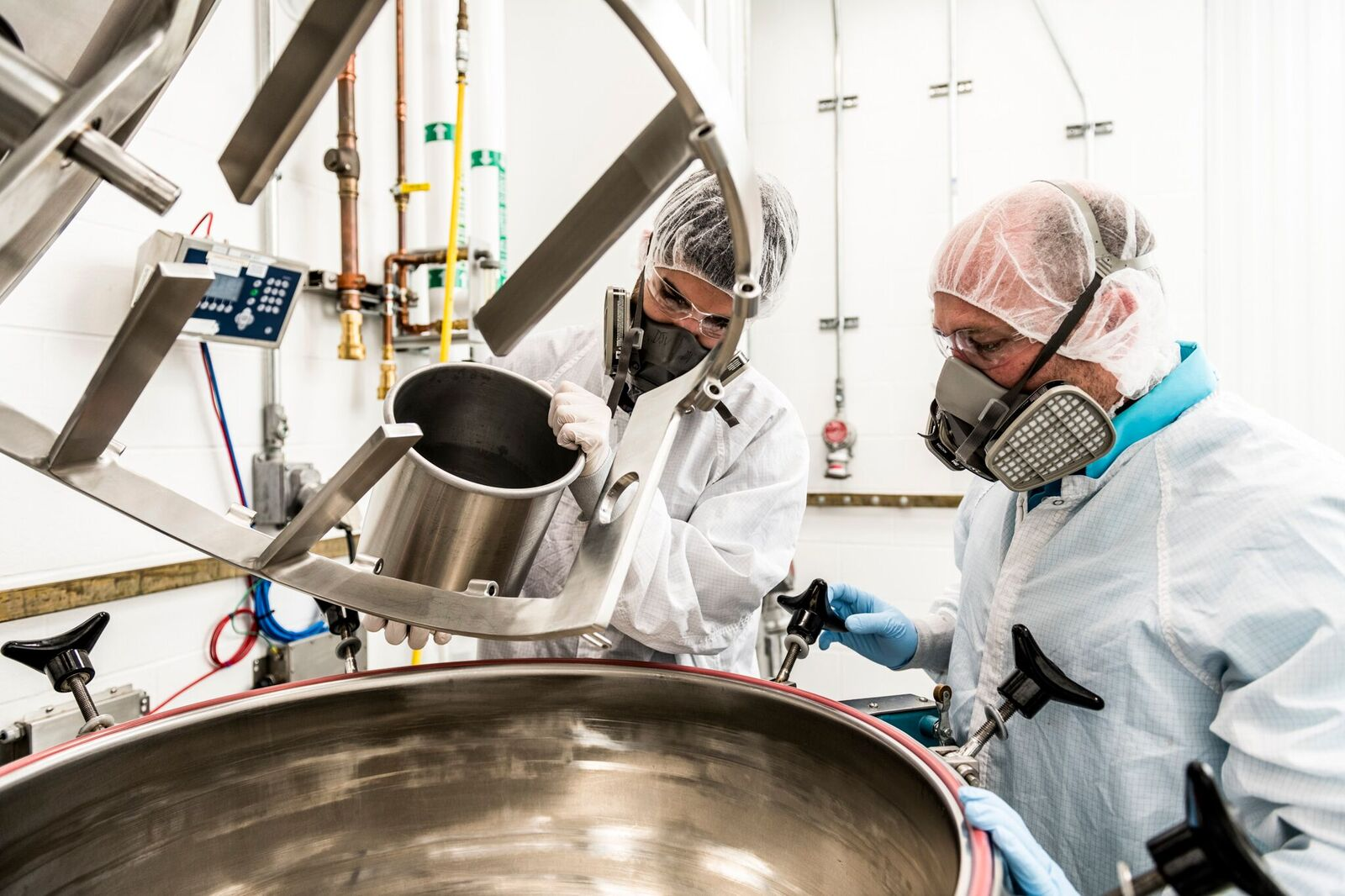 Tapemark employees conducting pharmaceutical mixing and blending