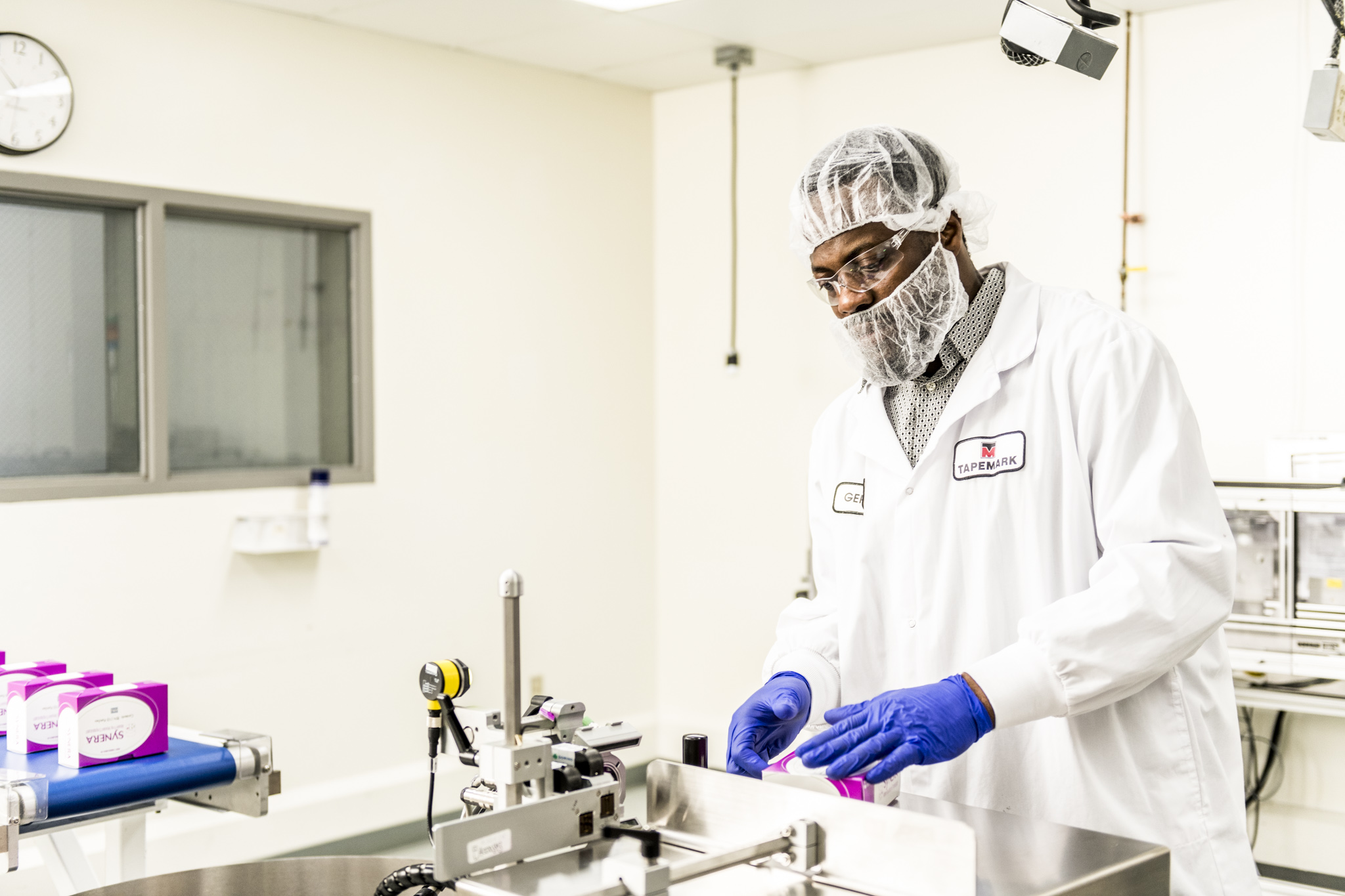 Tapemark employee working on pharmaceutical serialization
