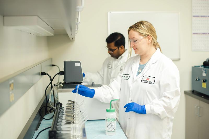 Picture of Marina Ruleva of Tapemark working on a drug formulation.